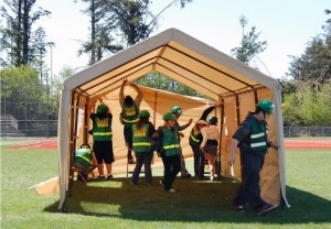 Taft High School Teen CERT students set up a tent that will be used to shelter students and  staff after a large earthquake.